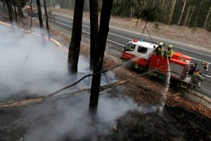 Cooler temperatures and rain take edge off Australian wildfires